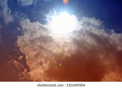 solar eclpise with clouds orange and blue