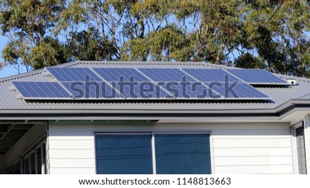 Solar Electric Panels On Metal Roof Stock Photo (Edit Now