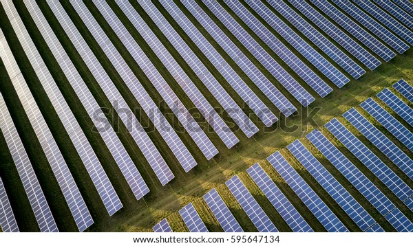Solar energy farm. High angle view of solar panels on an energy farm in rural england; full frame background texture.