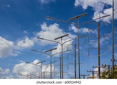 Solar energy light pole road with blue sky background