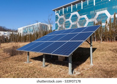 solar energy panel in front of buidling, december 10th, in gu-mi city, korea, the  buliding in background is eletronics test center of gu-mi city for apprioval to manufacture in company,