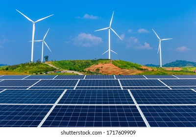 Solar energy panel photovoltaic cell and wind turbine farm power generator of renewable green energy.