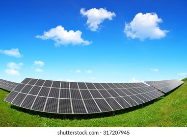 Solar energy panels against blue sky with clouds. Clean energy.