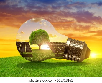 Solar energy panels in light bulb at sunset. The concept of sustainable resources. - Shutterstock ID 535718161
