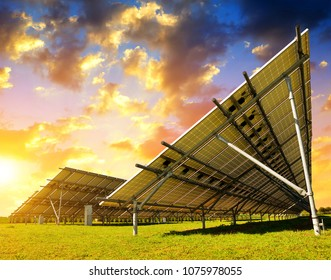 Solar energy panels in the meadow at sunset.Sustainable resources.