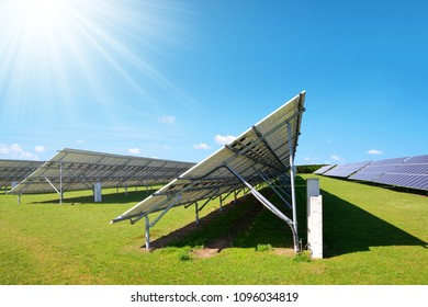 Solar energy panels on the meadow in sunny day. Sustainable resources.