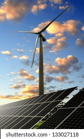 solar energy panels and wind turbine in the sunset