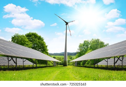 Solar energy panels with wind turbine in summer landscape. Power plant using renewable energy.