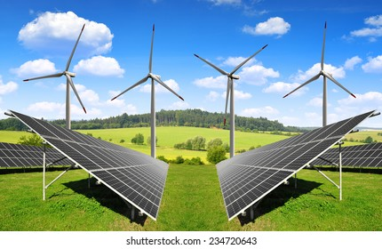 Solar energy panels with wind turbines in spring landscape