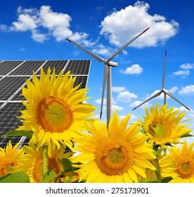 Solar energy panels with wind turbines in sunflower field. Green energy.