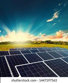 Solar energy power plant over a beautiful sundown sky