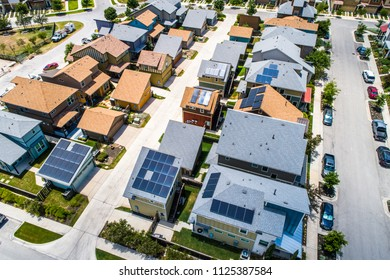 Solar energy rooftops producing clean renewable energy for the future. Real estate homes with Solar Panel Rooftops A Clean Renewable Neighborhood for the future in Austin , Texas , USA