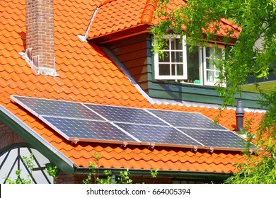 Solar energy system on roof of romantic Dutch house, Netherlands