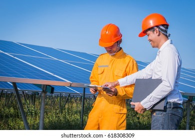 solar engineer and electrician checking and resolve problem of generate power in solar power plant