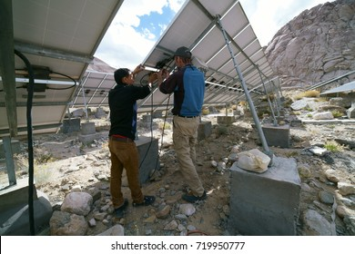 Solar engineers are seen repairing some solar panels at the Tangste power plant in Ladakh, Jammu and Kashmir, India. Shot in September 2016.