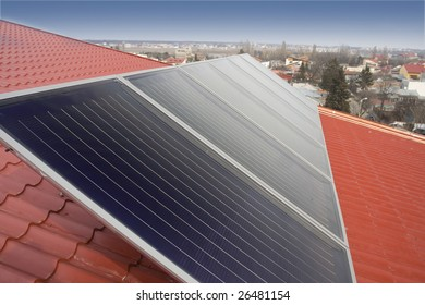 Solar enrgy made by solar panels on a house roof