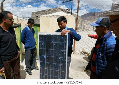 A solar expert is conducting a workshop to teach the local school kids about the production of solar energy. Shot in September 2016, in the small town of Tangste, Ladakh, Jammu and Kashmir, India.