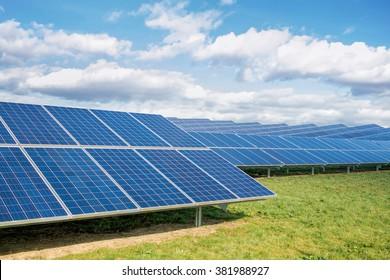 Solar Farm. Green Fields Blue Sky Solar Park, Sustainable Renewable Energy.