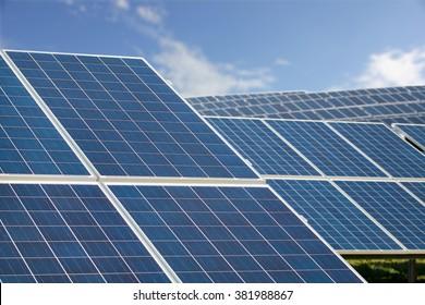 Solar Farm Park. Solar Panels Sunny Blue Sky, Sustainable Energy.