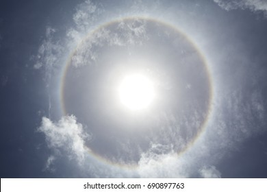 Solar Halo.  Also known as a 22 degree halo or a sun halo, the ring is caused by sunlight passing through ice crystals in cirrus clouds within the Earth's atmosphere,