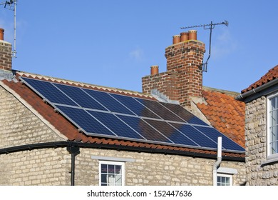 Solar heating panels. Hot water heated by the sun in a residential setting to provide domestic hot water. Solar hot water also has industrial applications, such as generating electricity.