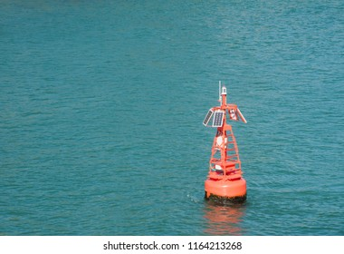 Solar marine buoy in the turquoise Pacific Ocean waters in Tauranga Harbour in New Zealand