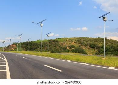 Solar modules panel on electric pole, use of Solar energy for lightning of highway, Rio de Janeiro, Brazil