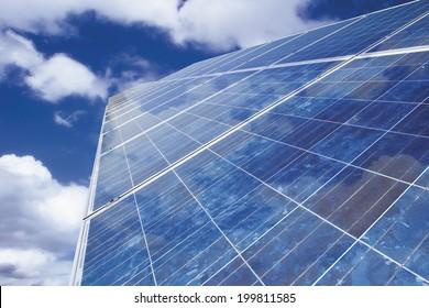 Solar panel against cloudy sky