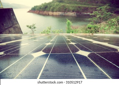 solar panel by the lake color processed