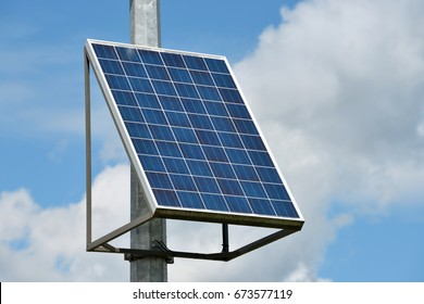 Solar panel or Solar cell with blue sky and clouds