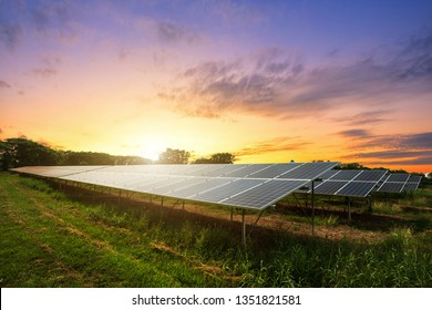 Solar panel cell on dramatic sunset sky background,  clean Alternative power energy concept.