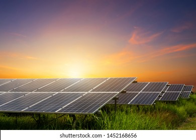Solar panel cell on dramatic sunset sky background,clean Alternative power energy concept.