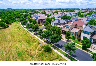 Solar Panel Community Mueller District of East Austin , Texas , USA 2019 aerial drone view of solar panel rooftops on suburb housing neighborhood