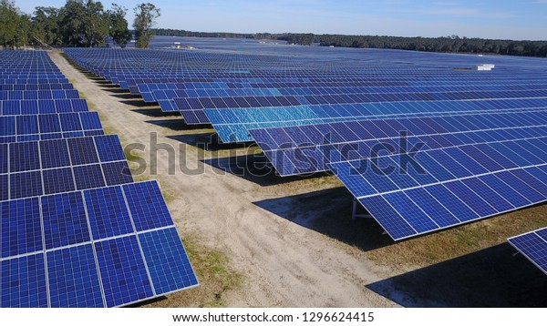 Solar Panel Farm on a sunny day, seen in 4K aerial in Columbia County, Florida, U.S.