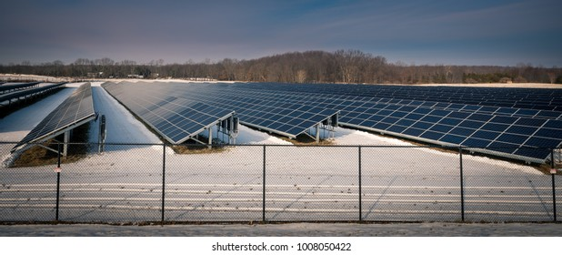 A solar panel farm on a winter afternoon