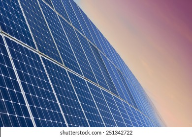 Solar Panel Field Aganinst The Sunrise