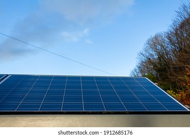 Solar panel generating electricity in low autumn light on a clear day in Scotland, United Kingdom