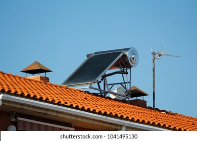 Solar panel for heating water and television antennas, in a roof of a house