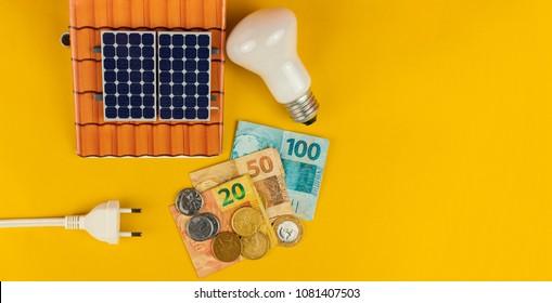 Solar panel, lamp, power plug and varied values of Brazilian mon