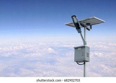 Solar panel lighting pole with blue sky and white clouds. Renewable Energy concept.