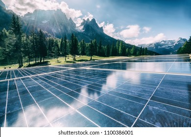 Solar panel on building in country landscape against sunlight shinning on solar cells. Solar power is the innovation for sustainability building of world energy.