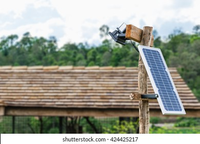 Solar panel on electric pole for lightning in the countryside home has no access to electricity