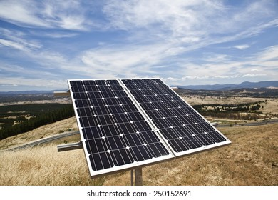 Solar panel on hill in front of stunning landscape in Australia