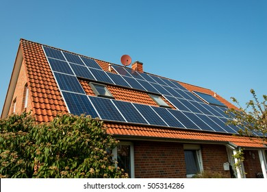 Solar panel on a red roof - renewable alternative energy source