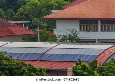 Solar panel on a red roof in morning