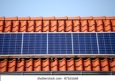 Solar panel on a red roof