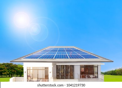 Solar panel on a roof of home with the sun and blue sky