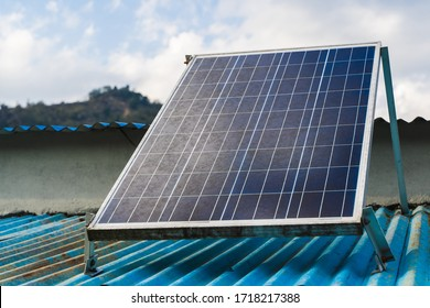 Solar panel on the roof of a house. Green and environmentally friendly sources of energy. Stock photo