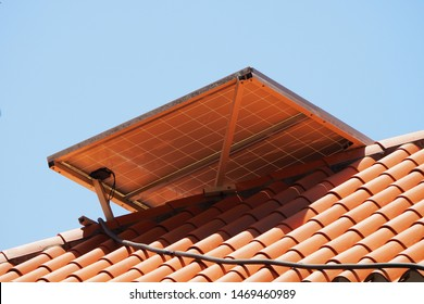 Solar panel on the roof of a private house. Sunny day.