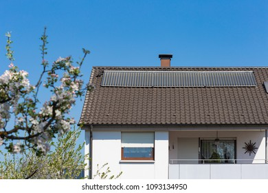 solar panel on rooftop of rural village in south germany countryside at springtime sunny day blue sky